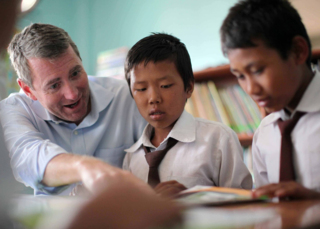 John Wood at a Room to Read library in Nepal.